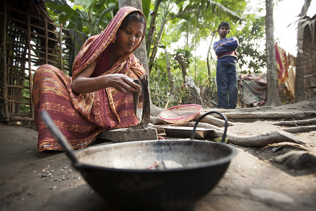 Cleaning fish in Khulna, Bangladesh. Photo by Felix Clay/Duckrabbit.