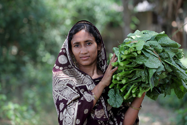 Woman carrying home vegetables in Khulna, Bangladesh.