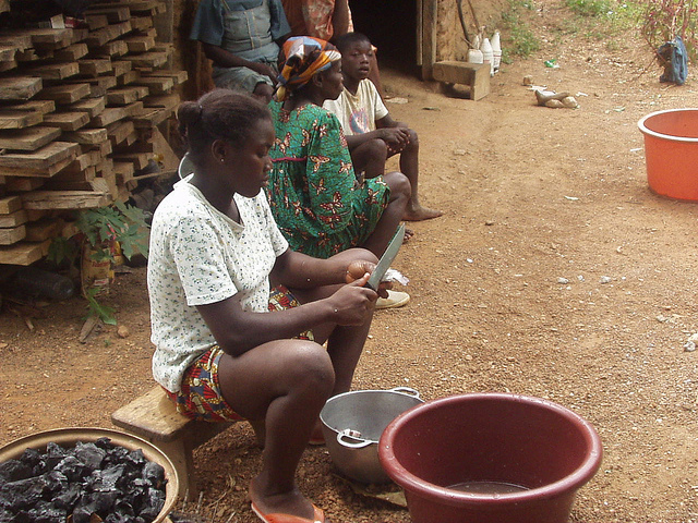 Woman cleaning fish, Cameroon.