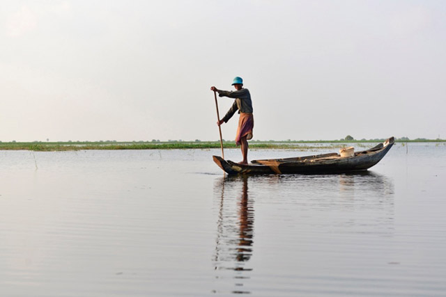 Fisherman returning home, Rohal Suong's conservation pond, Battambang province, Cambodia.
