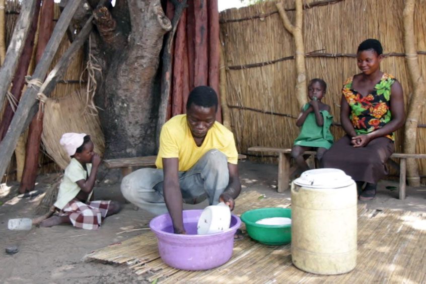 Justin Sibeso and his wife Mukatimui Nyambe from Mbanga village in Zambia's Barotse floodplain share all households tasks including cooking, cleaning, farming and deciding how to spend household income.