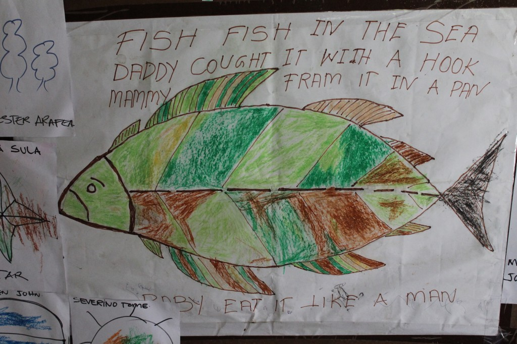 "A drawing and song - ""Fish fish in the sea, daddy caught it with a hook, mummy fried it in a pan, baby eats it like a man"" - from the kindergarten in a community in north Malaita Province, Solomon Islands. Pip Cohen, 2016."