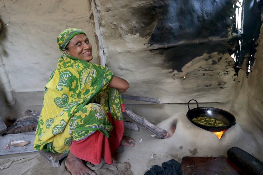 A woman cooking mola curry in her kitchen in Jessore, Bangladesh.