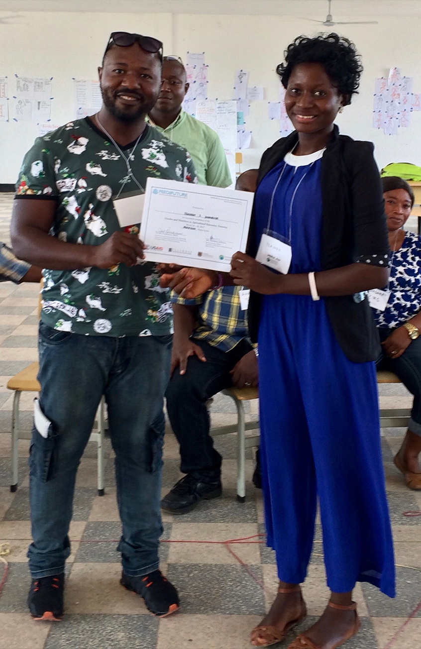 Yeanoh receives a certificate for completing a 3-day Integrating Gender and Nutrition within Agricultural Extension Services Workshop.