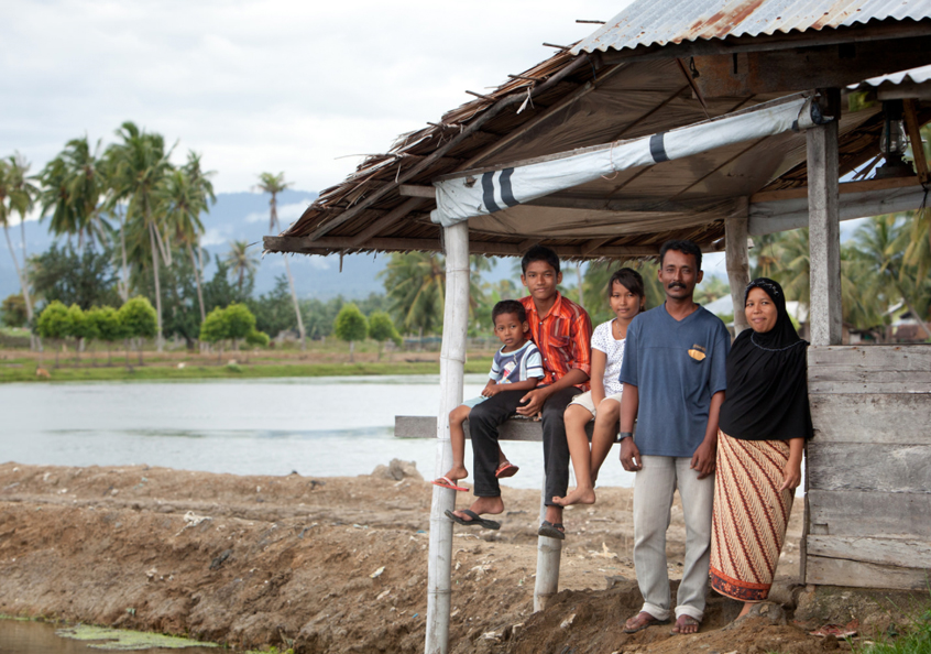 Shrimp farmer Rusli and his family, Aceh, Indonesia. Photo by Mike Lusmore.